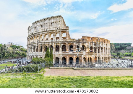 Picturesque aerial panoramnic view on the Great Roman Colosseum ( Coliseum, Colosseo ),also known as the Flavian Amphitheatre. Famous world landmark. Scenic urban landscape. Rome. Italy. Europe