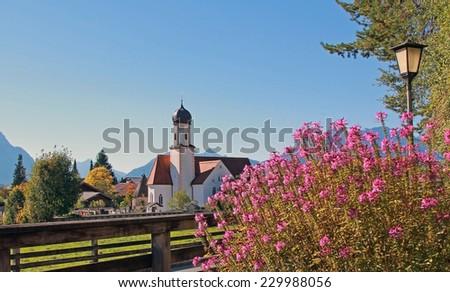 picturesque alpine village and church, wallgau, bavarian landscape - stock photo