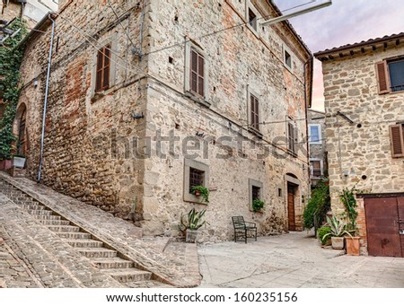 picturesque ancient corner, narrow alley and stairway in medieval town Gualdo Cattaneo, Umbria , Italy - stock photo
