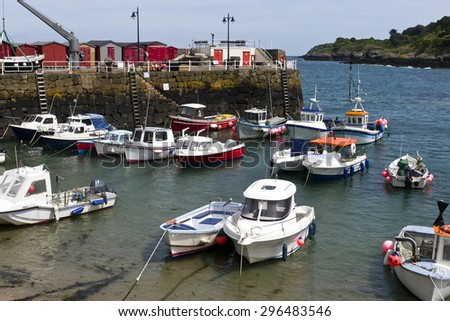 Picturesque bay with fishing boats; beautiful coastal inlet with fishing and leisure vessels