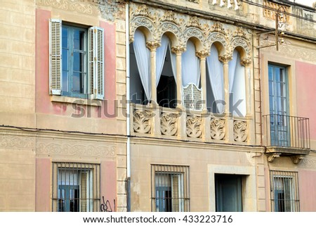 Picturesque buildings next to railway in the city of Calella, Catalonia