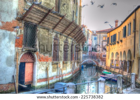 picturesque canal in Venice, Italy. iso 100, heavy processed for hdr tone mapping effect. - stock photo