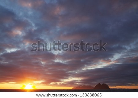 Picturesque cloudscape with midnight sun on Lofoten islands in Norway