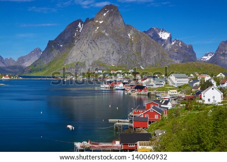 Picturesque fishing town of Reine by the fjord on Lofoten islands in Norway - stock photo