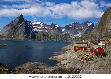 Picturesque fishing village on the coast of fjord on Lofoten islands in Norway - stock photo