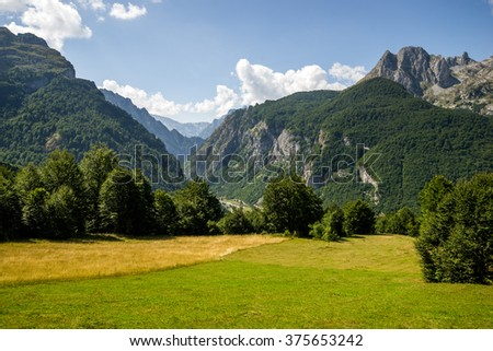 picturesque green valley of the mountains in summer day - stock photo