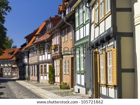 Picturesque half timbered houses in Wernigerode, Germany. Wernigerode is located in the district of Harz, Saxony-Anhalt, and also located on the German Half-Timbered House Road. - stock photo