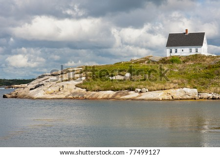 Picturesque house on the rocks in Peggys Cove, Nova Scotia - stock photo