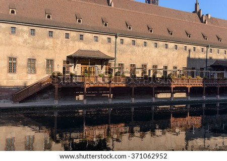 Picturesque houses along the Rur River in the historic center of Strasburg, building of old customs - stock photo