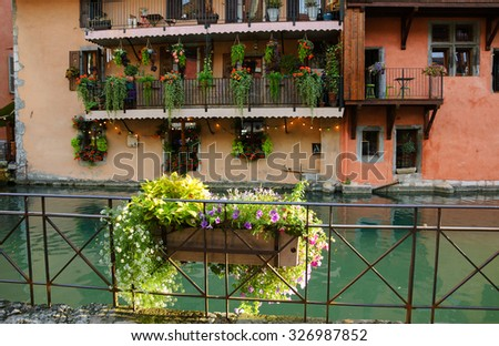 Picturesque houses over the canal in old town of Annecy (France) at sunset.  - stock photo