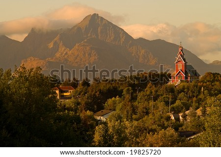 Picturesque landscape of the stave church over high mountains - stock photo