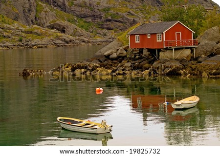 Picturesque landscape with fisherman hut, sea and mountains - stock photo