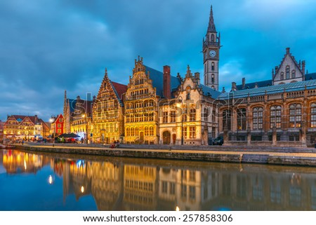 Picturesque medieval building and Clock Tower on the quay Graslei in Leie river at Ghent town at morning, Belgium - stock photo