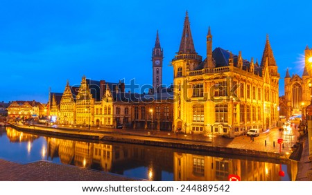 Picturesque medieval building and Post palace on the quay Graslei in Leie river at Ghent town at evening, Belgium - stock photo