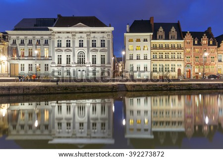 Picturesque medieval building on the quay Korenlei with reflections in Ghent town at night, Belgium - stock photo