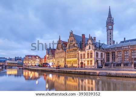 Picturesque medieval buildings on the quay Graslei and Leie river at Ghent town in the evening, Belgium - stock photo