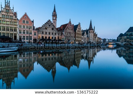 "Picturesque medieval buildings overlooking the ""Graslei harbor"" on Leie river in Ghent town, Belgium, Europe."