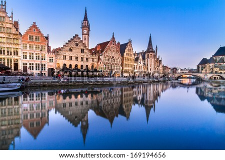 "Picturesque medieval buildings overlooking the ""Graslei harbor"" on Leie river in Ghent town, Belgium, Europe. - stock photo"
