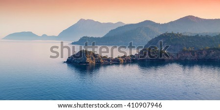Picturesque Mediterranean seascape in Turkey. Colorful evening panorama of a bay near the Tekirova village, District of Kemer, Antalya Province. Artistic style post processed photo. - stock photo