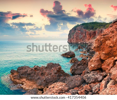 Picturesque Mediterranean seascape in Turkey. Colorful sunrise in the azure bay on Gelidonya peninsula, District of Kumluca, Antalya Province. Artistic style post processed photo.