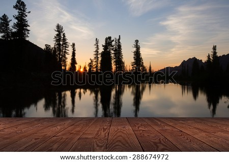 Picturesque mountain lake at sunset in the mountains of the Western Sayan Ergaki in summer