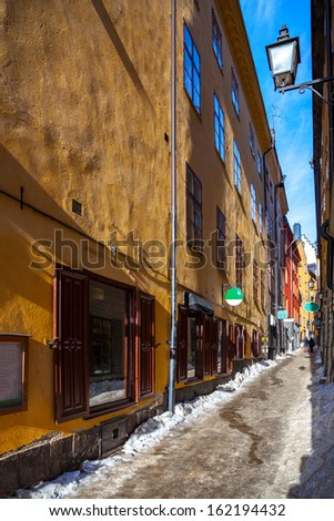 Picturesque narrow street in Old Town in Stockholm, Sweden. - stock photo