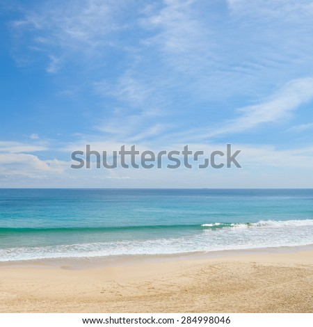 picturesque ocean coast and blue sky - stock photo