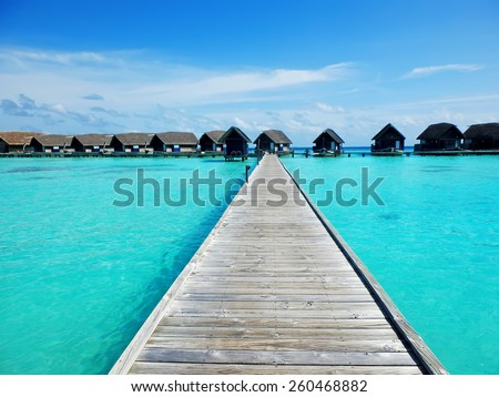 Picturesque pathway in Cocoa island hotel in the Maldives - stock photo