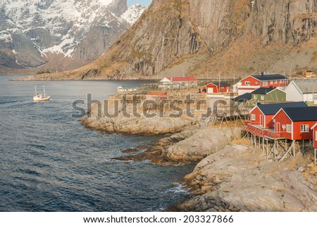 Picturesque red fishing huts, called rorbu in the hamlet of Hamnoy,Lofoten islands, Norway  - stock photo