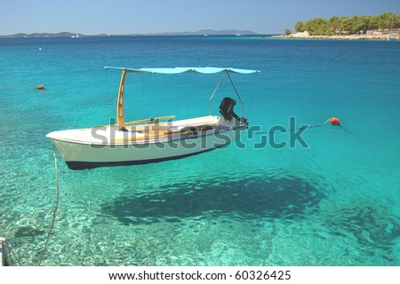 Picturesque scene of a boat in a quiet bay of Milna on Brac island, Croatia - stock photo