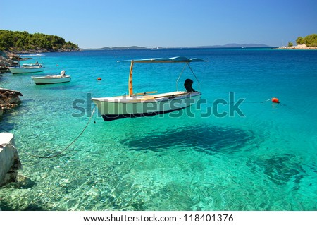 Picturesque scene of boats in a quiet bay of Milna on Brac island, Croatia - stock photo