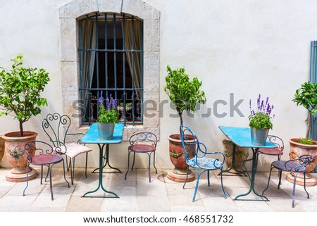 picturesque scene with vintage tables and chairs in the Provence, France