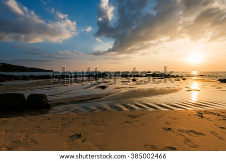 Picturesque seaview, sunset in Andaman sea, Naithon beach, Phuket. Dramatic sunset at Naithon Beach, Phuket, Thailand - stock photo