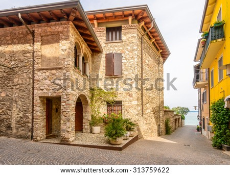 Picturesque small town street view in Sirmione, Lake Garda Italy. - stock photo