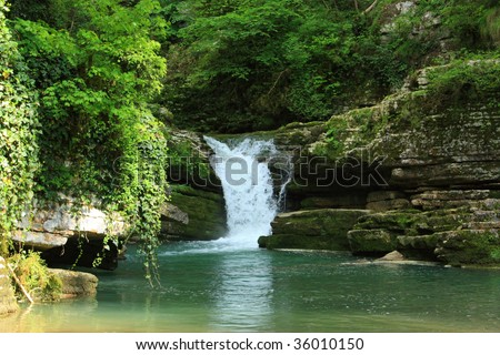 picturesque small waterfall on the river in the canyon