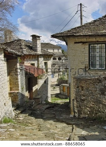Picturesque street  in a mountainous Greek village - stock photo