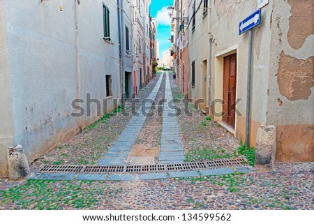 picturesque street in Alghero old town - stock photo