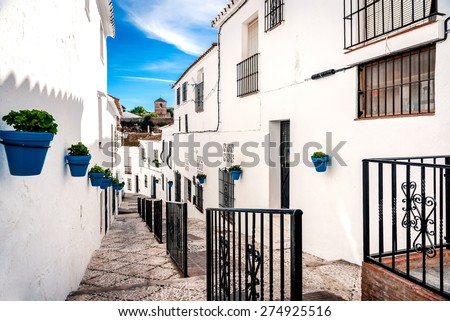 Picturesque street of Mijas. Charming white village in Andalusia, Costa del Sol. Southern Spain - stock photo