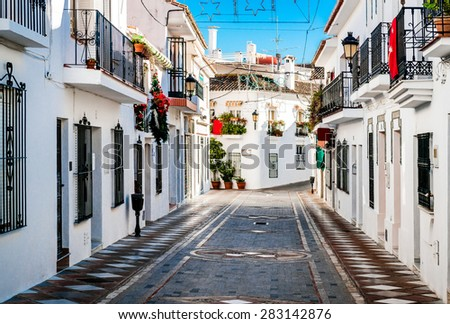 Picturesque street of Rancho Domingo. Charming white village in Benalmadena. Andalusia, southern Spain - stock photo