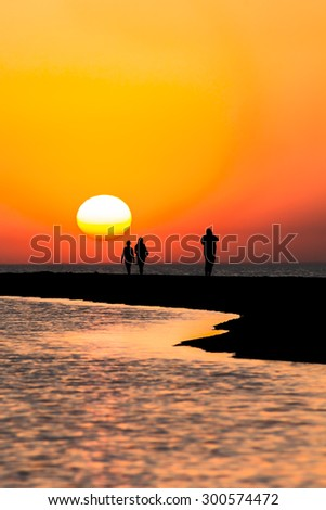 Picturesque  sunset over  the sea on the summer evening - stock photo