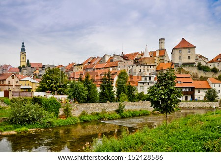 Picturesque town Bystrzyca Klodzka (germ. Habelschwerdt), On the left St. Michael Archangel church, on right Knights Tower - stock photo
