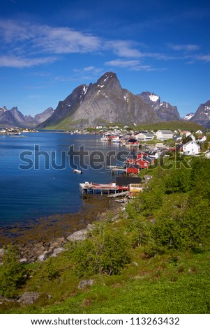 Picturesque town of Reine by the fjord on Lofoten islands in Norway - stock photo