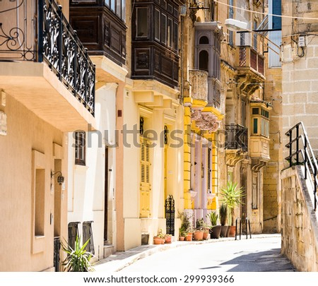picturesque typical narrow street of Valletta in Malta - stock photo