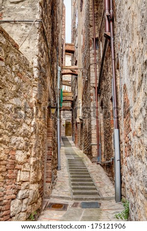 picturesque very narrow alley with staircase in the old town Todi, Umbria, Italy  - stock photo