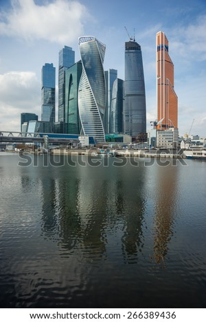 Picturesque view of the Moscow City across the river Moscow with reflection in water, Moscow, Russia