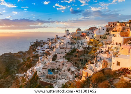 Picturesque view, Old Town of Oia or Ia on the island Santorini, white houses, windmills and church with blue domes at sunset, Greece - stock photo