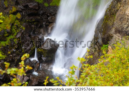Picturesque waterfall Svartifoss in Skaftafell National Park of Iceland. Black stones in streams of water - stock photo