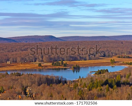 Picturesque wintry valley and lake. A view onto the West Virginia valley at sunset. - stock photo