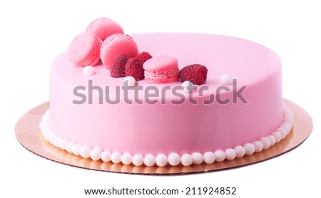 pie in pink glaze decorated macaroons and raspberry - stock photo