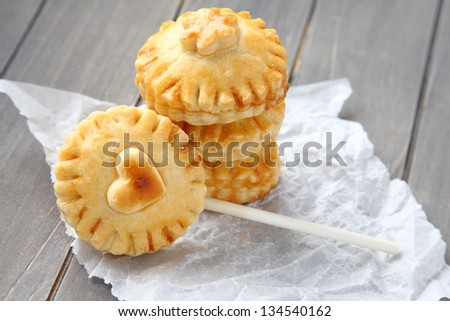 Pie pops with chocolate. Homemade shortbread cookies on a stick - stock photo